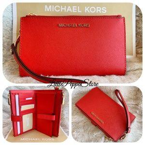 d9e270364e11 MICHAEL Michael Kors · MICHAEL KORS DOUBLE ZIP WRISTLET WALLET DK SANGRIA